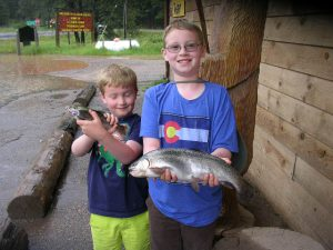 "Max(age 7) And Ian(age 9) From Denver With Their Catch From The Kid's Pond..19"" Rainbow Using A Mealworm"