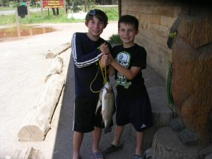 Nico (age 11) And Brother Joaquin(age 8) From Tucson With Their Catch From The Kid's Pond. 17 1/2 Inch Rainbow Caught On A Lure