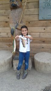 "Seven Year Old Madison From Belen With Her 11"" Brown From Fenton Lake"